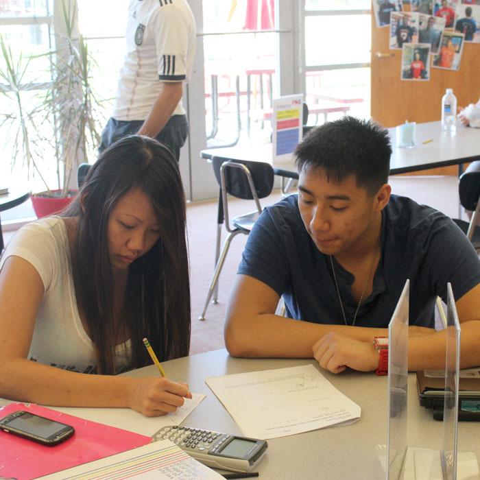 Senior Dylan Duong tutors senior Thi Le in the Lit Center