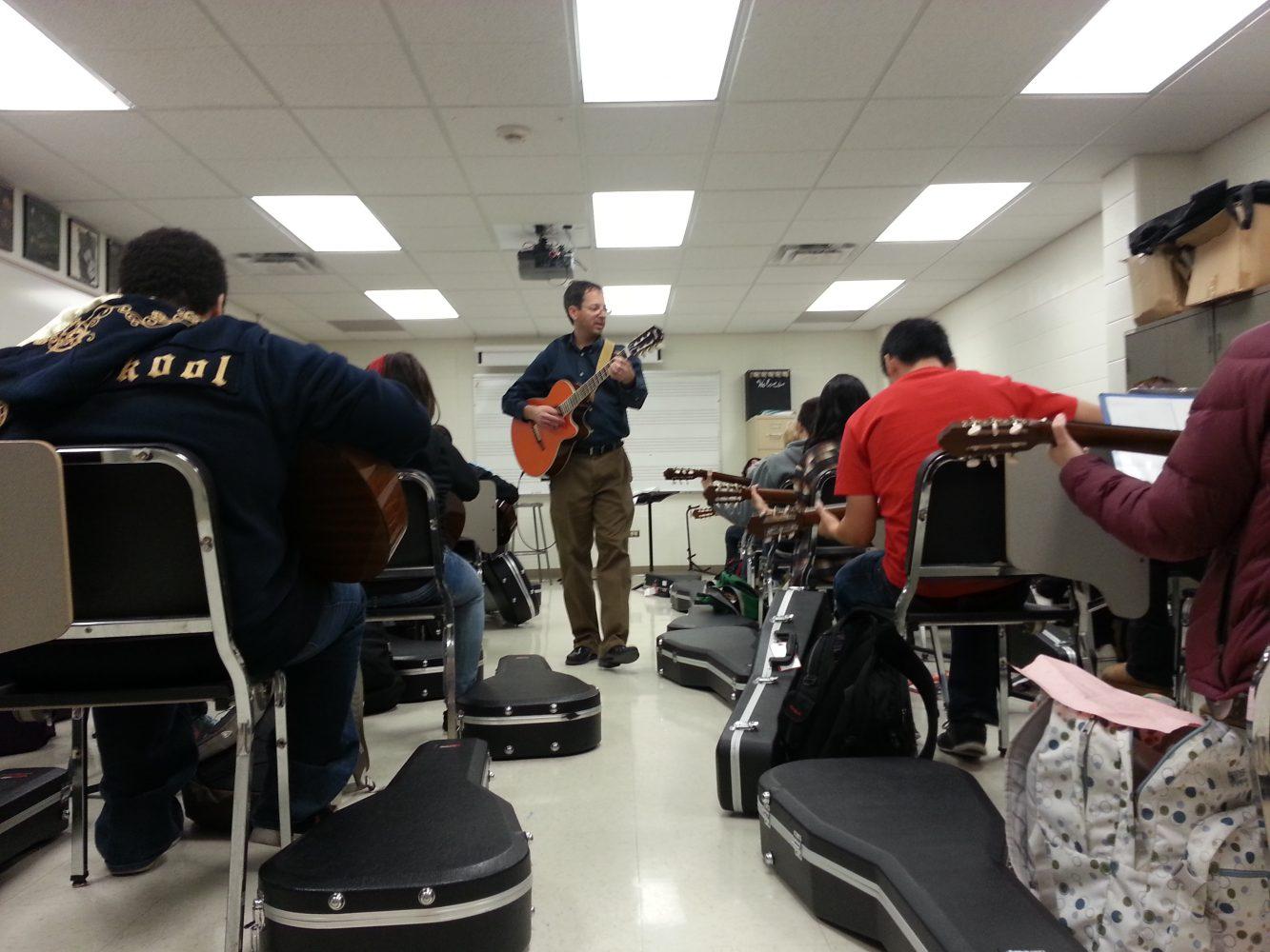 Music teacher Steven Katz conducts Guitar.