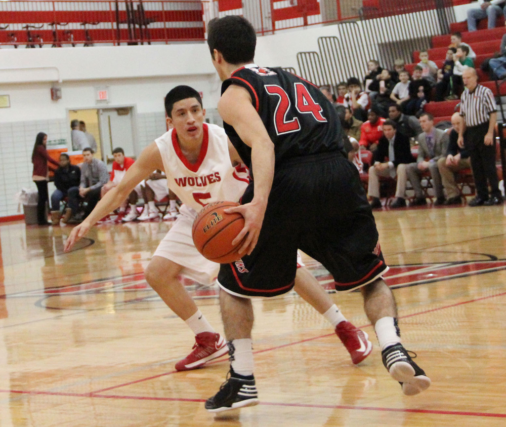 Senior+Alfredo+Gonzalez+defends+a+Maine+South+ball+handler+during+Friday%27s+loss+to+the+Hawks.+Maine+South+won+50-29.+PHOTO+by+Vinny+Kabat