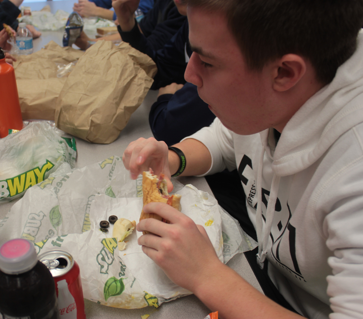 Junior John Kruk eats Subway to boycott Organic Life's cafeteria food during #lunchstrike2013 Tuesday, Jan. 29. PHOTO by Alyssa Guzman