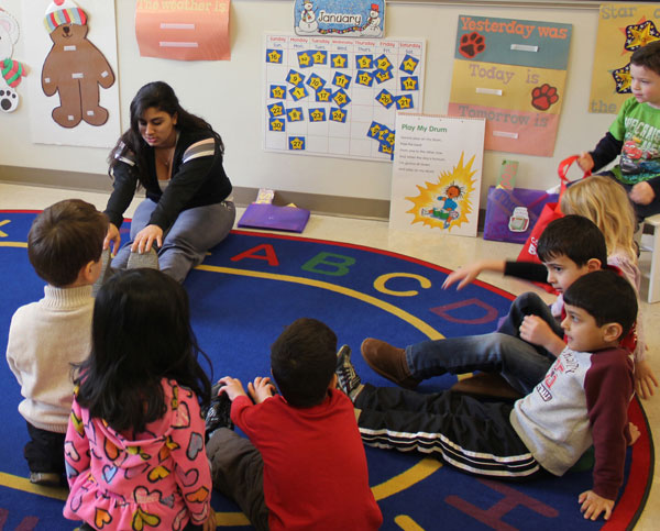 Senior Amara Fakhoury instructs a group of pre-school students last year. The community preschool closed its doors second semester. NWN File photo