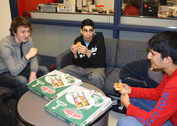 Students eat take-out pizza instead of buying lunch in the cafeteria Friday, Feb. 1.