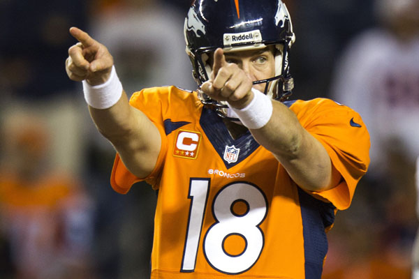 Denver Broncos quarterback Peyton Manning (18) gestures during 4th-quarter action against the Oakland Raiders at Sports Authority Field at Mile High Stadium in Denver, Colorado, Monday, September 23, 2013. (Kent Nishimura/Colorado Springs Gazette/MCT)