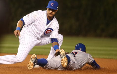 Chicago Cubs second baseman Starlin Castro, left, tags out the New York Mets' Curtis Granderson on an attempted steal in the first inning during Game 3 of the NLCS on Tuesday, Oct. 20, 2015, at Wrigley Field in Chicago. (Brian Cassella/Chicago Tribune/TNS)