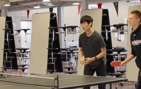 The Niles West ping pong during an after school practice.