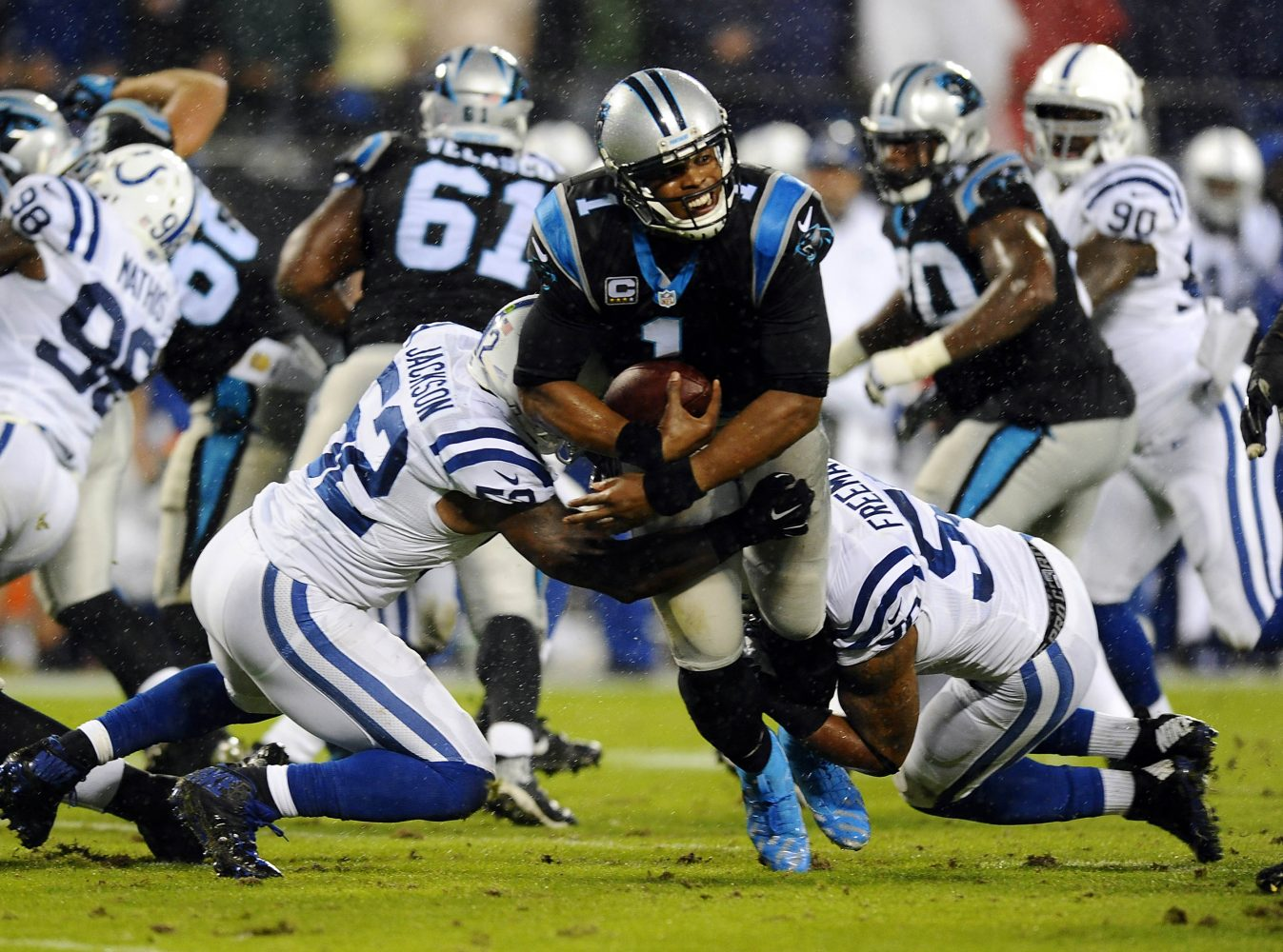 Carolina Panthers Cam Newton (1) breaks past Indianapolis Colts DQwell Jackson (52) and Jerrell Freeman (50) for a first down during the first quarter on Monday, Nov. 2, 2015, at Bank of America Stadium in Charlotte, N.C. (David T. Foster III/Charlotte Observer/TNS)