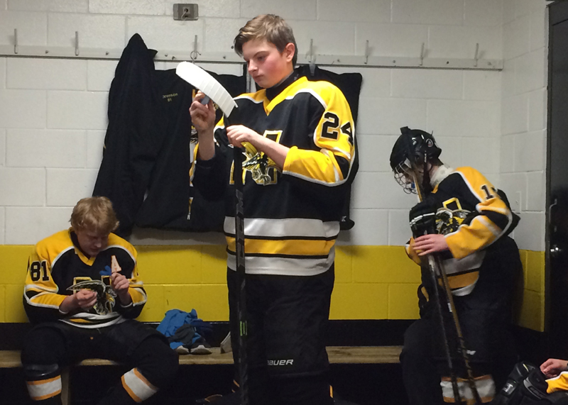 Sophomore+Vadym+Scherba+waxes+his+hockey+stick+before+a+game
