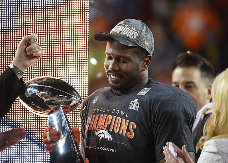 Super Bowl MVP Von Miller holds the Vince Lombardi trophy during the postgame celebration after a 24-10 win against the Carolina Panthers in Super Bowl 50 at Levi's Stadium in Santa Clara, Calif., on Sunday, Feb. 7, 2016. (Anthony Behar/Sipa USA/TNS)
