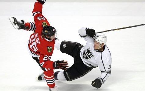 Chicago Blackhawks right wing Dale Weise (25) collides with Los Angeles Kings defenseman Brayden McNabb (3) during the second period on Monday, March 14, 2016, at the United Center in Chicago. (Nuccio DiNuzzo/Chicago Tribune/TNS)