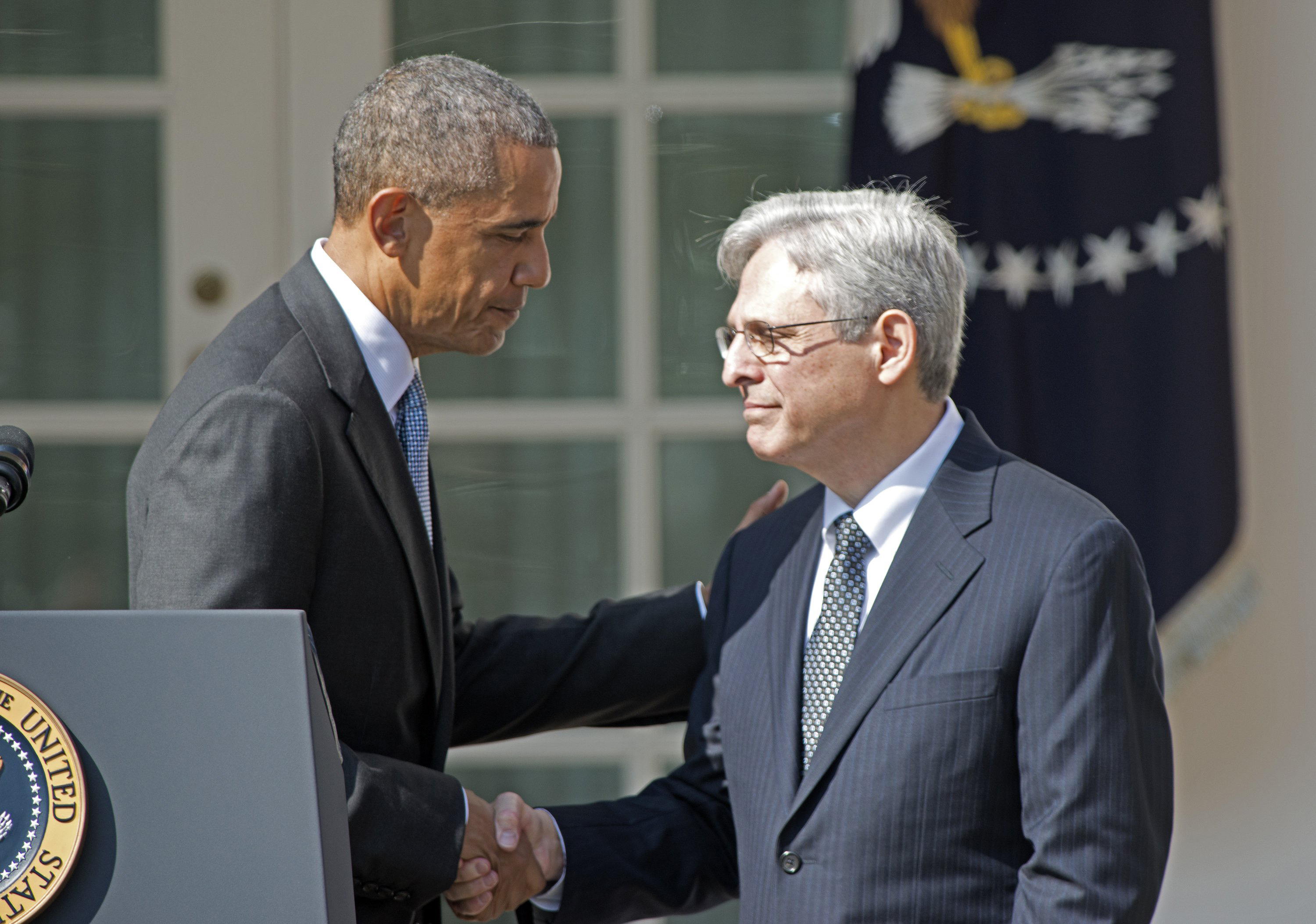 President Barack Obama, left, shakes hands with Judge Merrick Garland, chief justice for the U.S. Court of Appeals for the District of Columbia Circuit, right, after announcing him as his nominee for the Supreme Court in the Rose Garden of the White House on Wednesday, March 16, 2016. (Ron Sachs/CNP/Sipa USA/TNS)