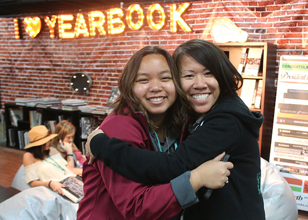 Senior Reiczel Bael from Kennedy High School in La Palma, CA, poses with advisor, Catherine Fong while walking around the exhibition room of the Spring JEA/NSPA Journalism Convention taking place at the Westin Bonaventure hotel located in Los Angeles, CA. Photo by Emily Butera