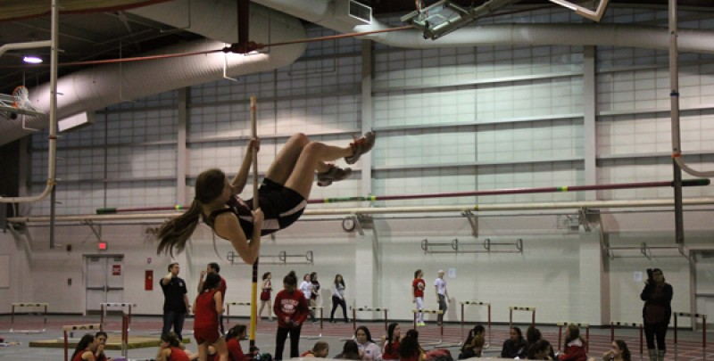 A pole vaulter on the girls indoor track and field season practices during the 2017 season.