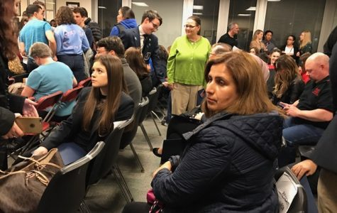 Parents and students gather before the D219 board meeting Tuesday, April 4. Photo by Divitya Vakil