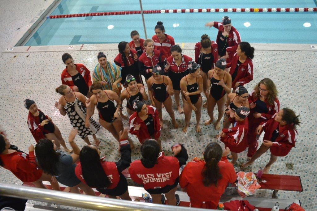 The+girls+swim+team+conversing+during+a+meet.+