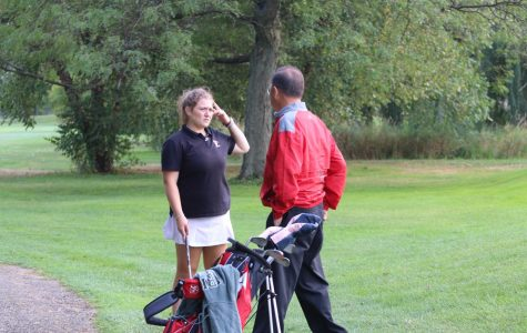 Last year's girls varsity golf team preparing to tee off at one of their matches.
