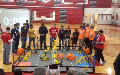 The Niles West VEX Robotics team hard at work during a competition.