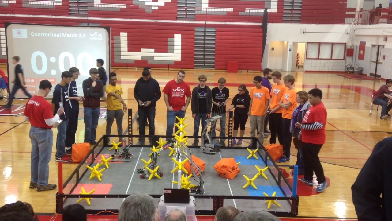 The+Niles+West+VEX+Robotics+team+hard+at+work+during+a+competition.