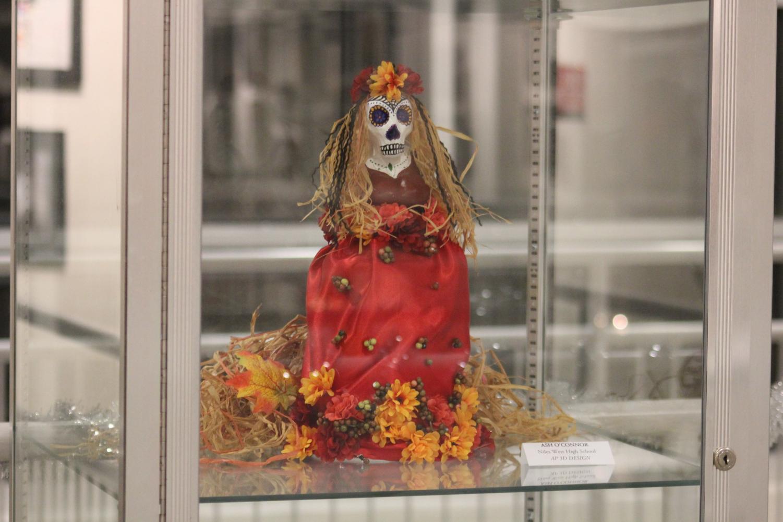 Doll put on display for Dia de los Muertos art show.