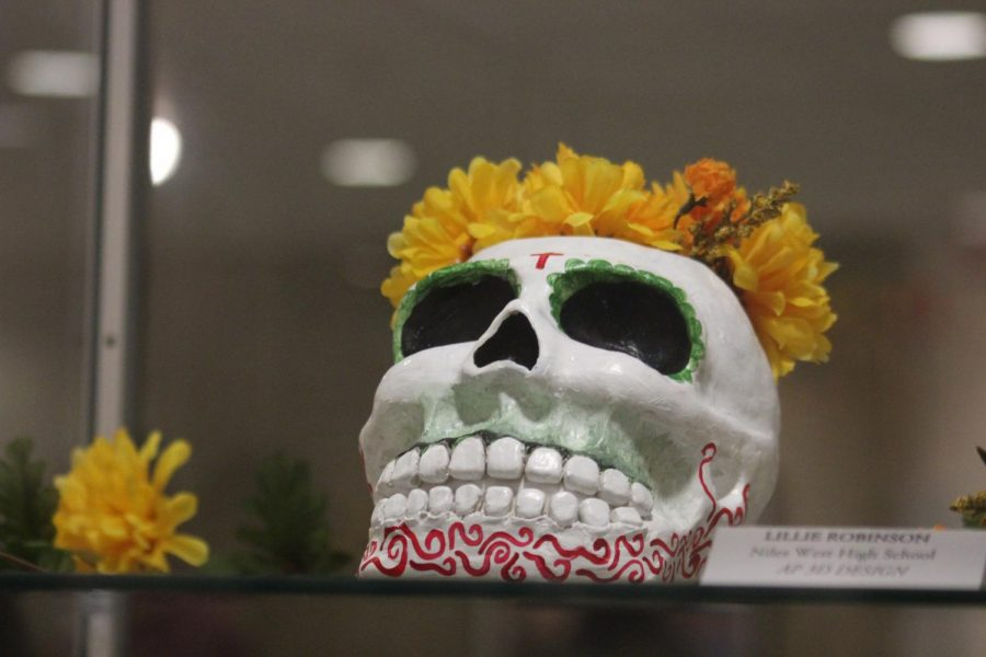 A colorful skull created by a student for the Dia de los Muertos display.