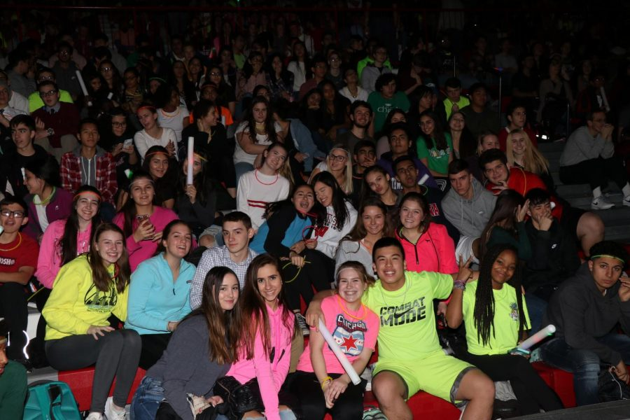 The+junior+class+shows+off+their+spirit+for+the+winter+pep+assembly+wearing+neon.