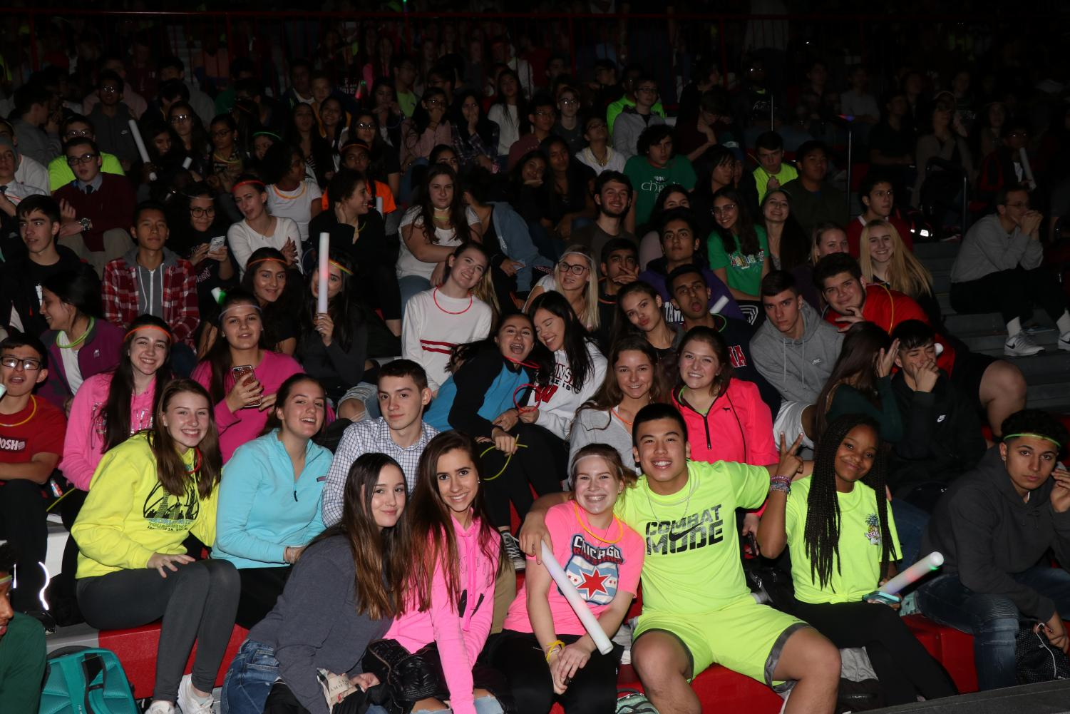 The junior class shows off their spirit for the winter pep assembly last year by wearing neon.