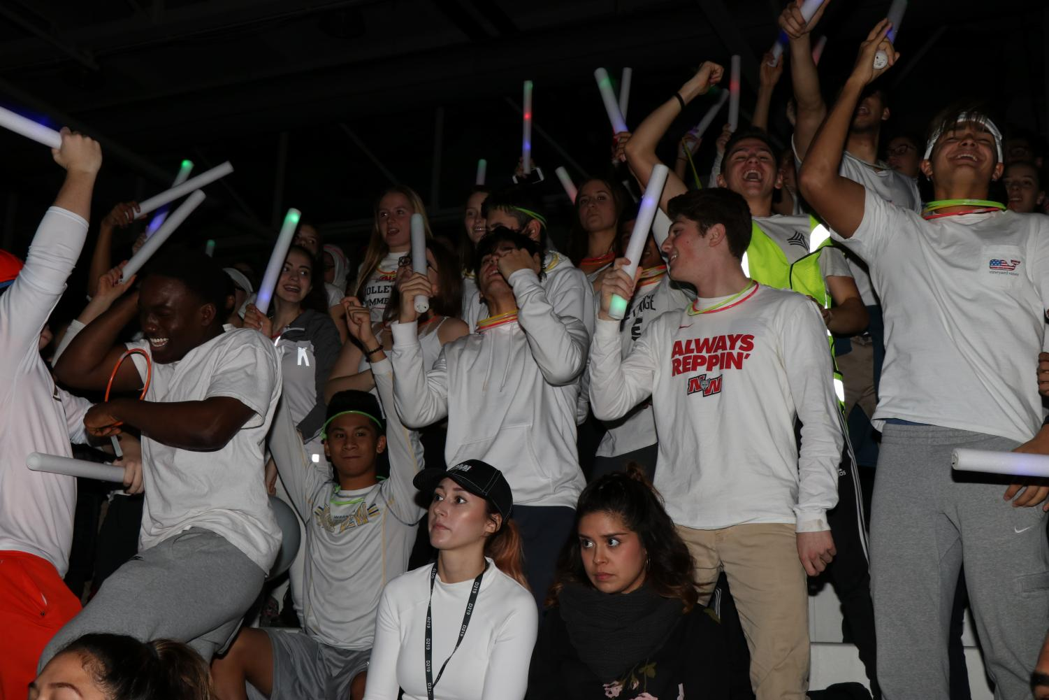 Senior class wears white to show off their school spirt at pep assembly.