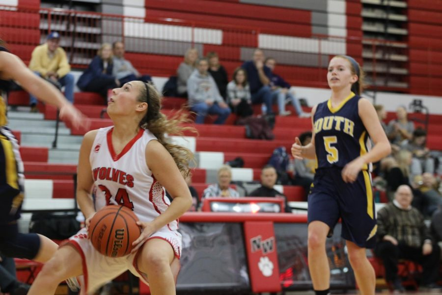 Junior Sammie Simkins gets ready to take a shot for the Wolves.