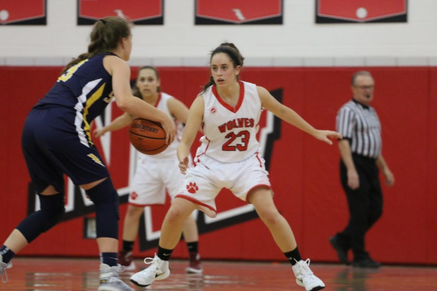 Senior Tricia Pabst plays hard defense against Glenbrook South.