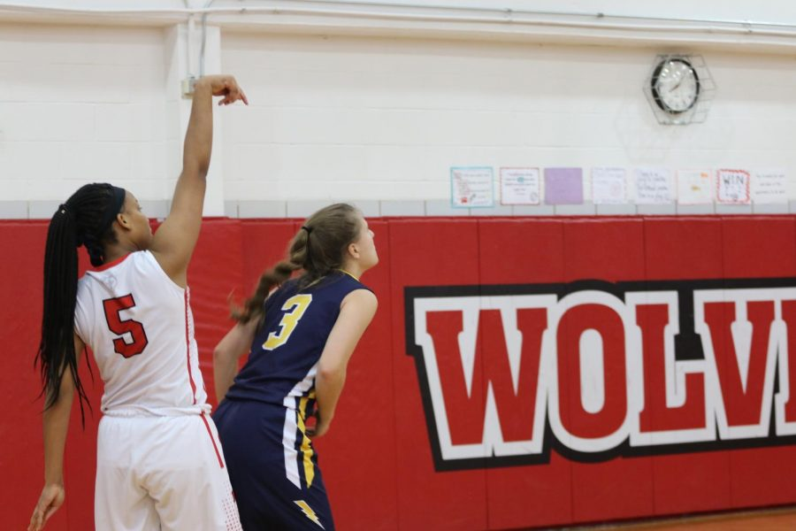 Howell takes her shot to add to the Wolves score.