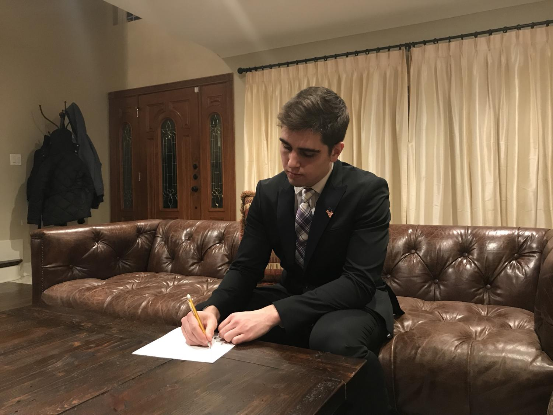 Senior Nasko Pelinkaj drafts his speech for a school board meeting.