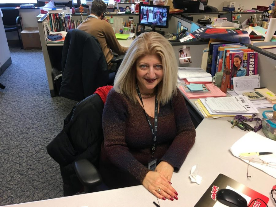 Linda Capuzelo-Akechoud at her desk in the Foreign Language Office.