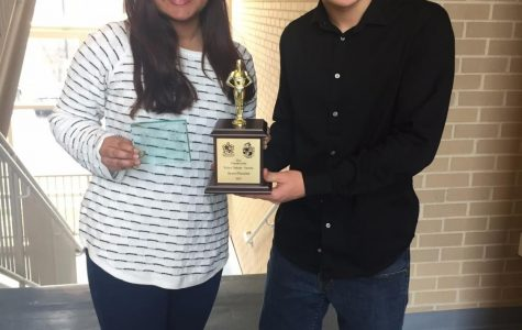Sihah Reza (left) after winning an award at a national tournament.