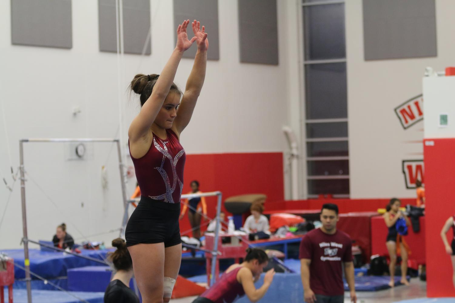 Junior Jasmine Dirks gets ready to perform her routine on the beam.