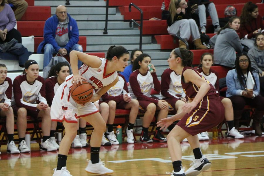 Junior Sam Galanopoulos brings up the ball one on one against Schaumburg.