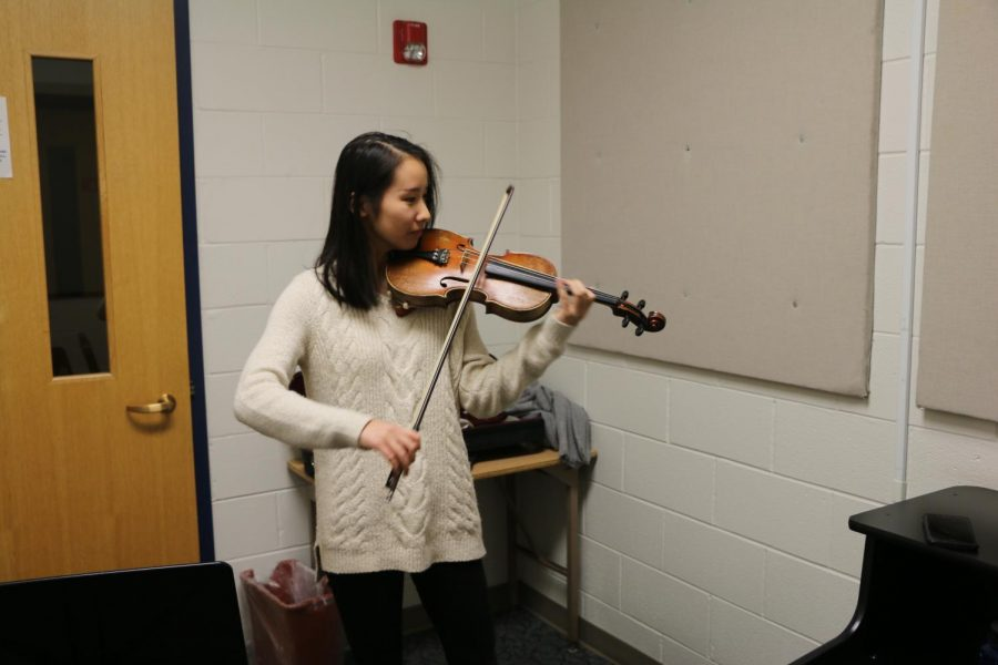 Leah Zhao practices her violin to prepare for her upcoming concert.