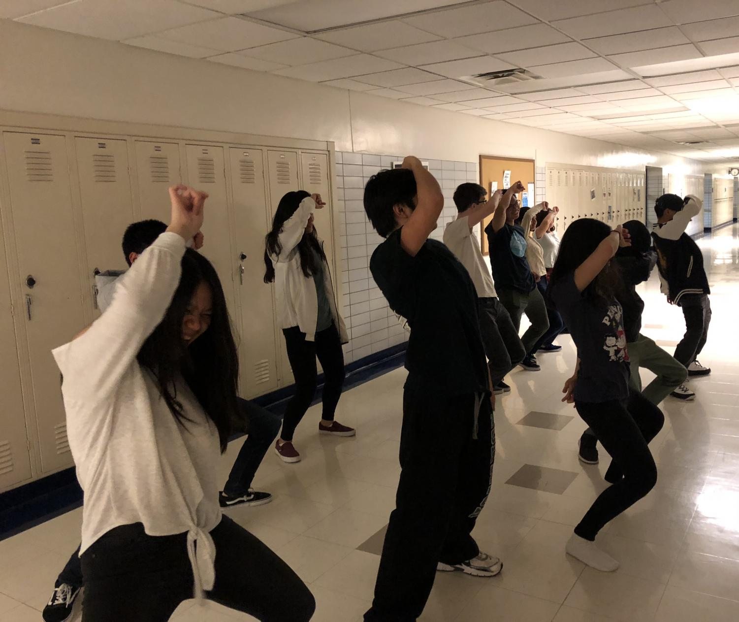 Students in Asian Pop Culture Club practice their dance during a meeting.