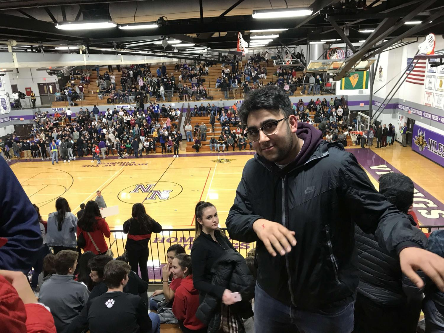 Senior Amir Shirsalimian is a fixture at Niles West sporting events.