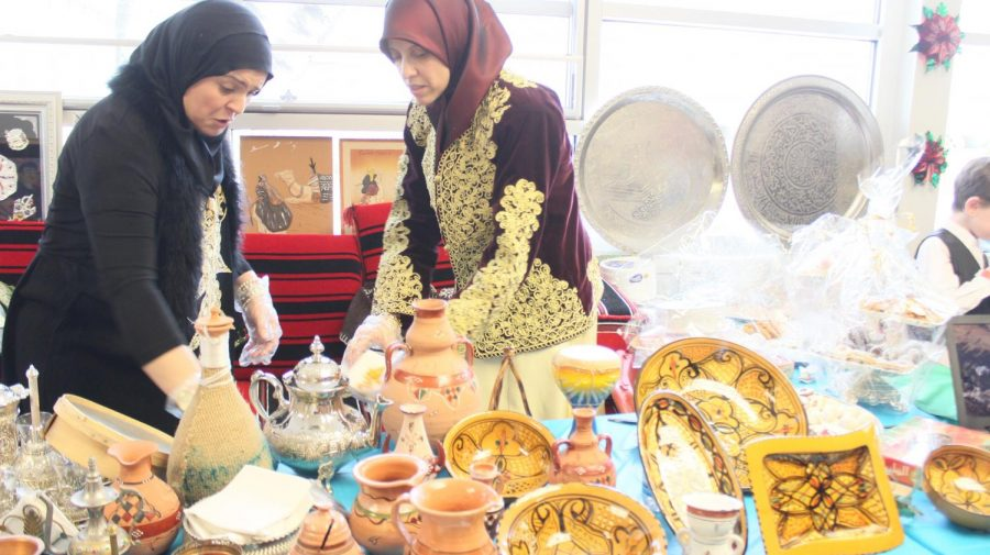 Intricate dishes are presented at a cultural booth.