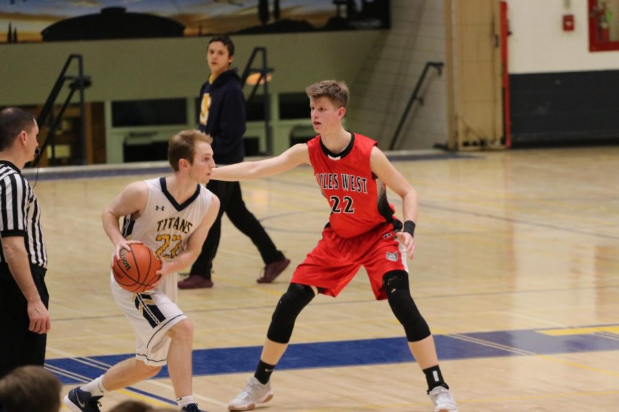 Senior Jack Milios gets down in a defensive stance against Glenbrook South.