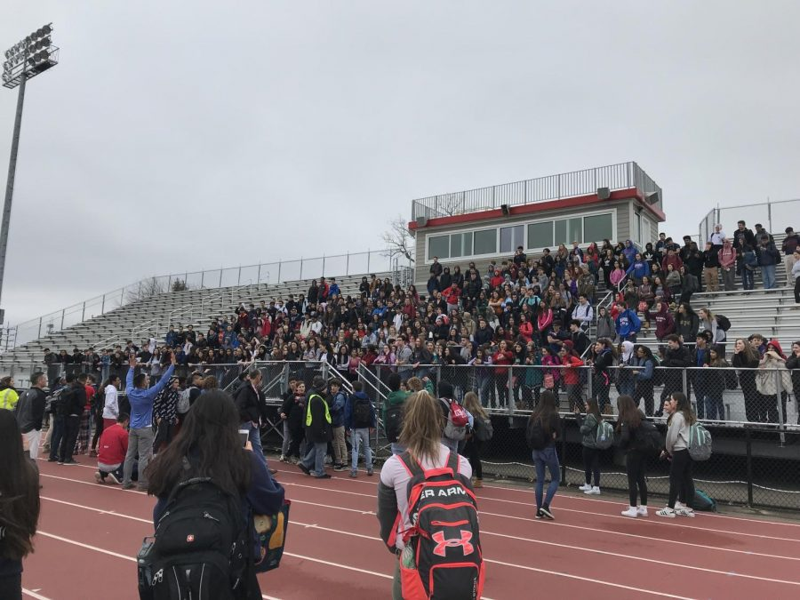 Students filed into the football stadium during a walkout against gun violence on Fri., Feb. 23.