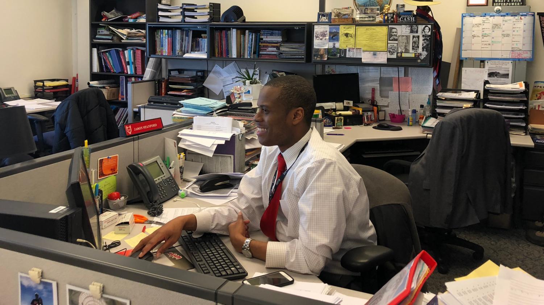 Social Studies teacher Jason Stanford hard at work in his office.