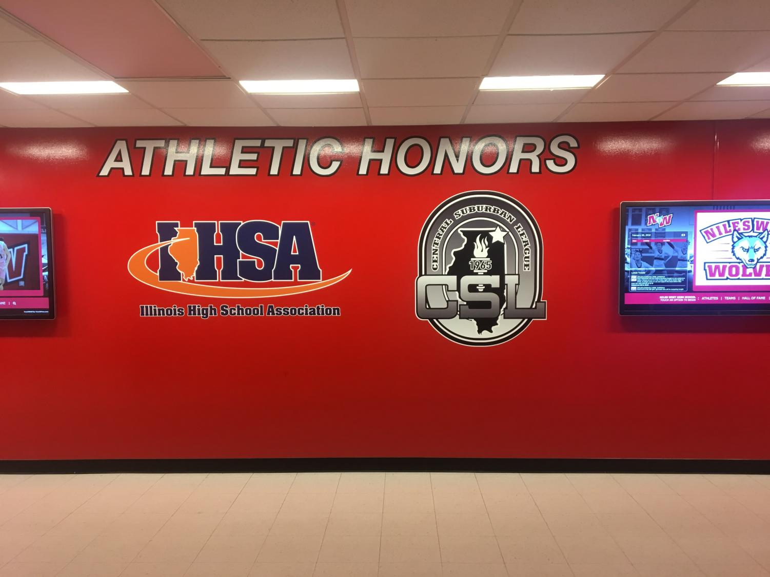 The newly painted and updated Athletic Honors wall, complete with two new touch screen display monitors.