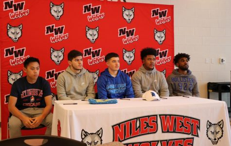 Aaron Nguyen, Edin Sabovic, Jaylen Bryant, Isaiah Elhamti, and Davion Lewis sign their National Letter on Intent.