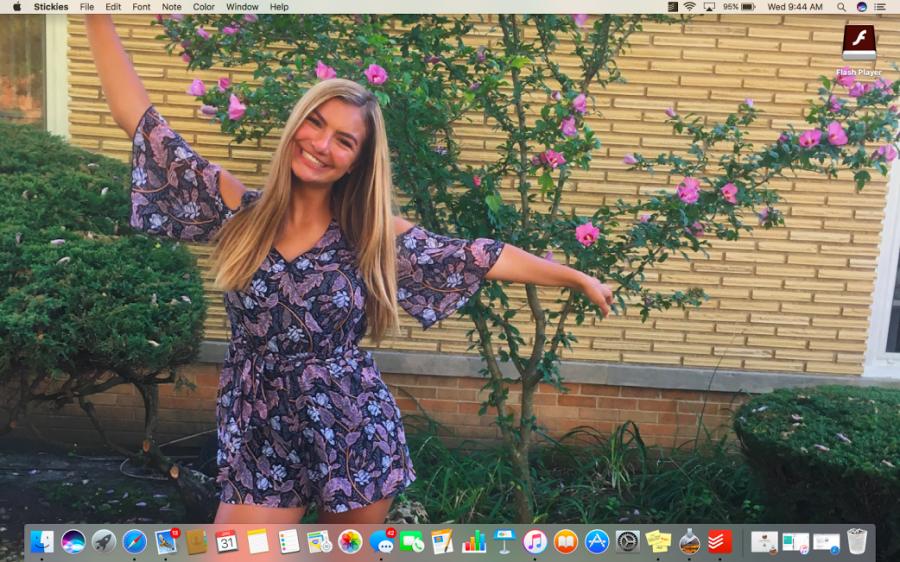Managing editor Christina Lappas displaying herself as her own laptop screensaver.