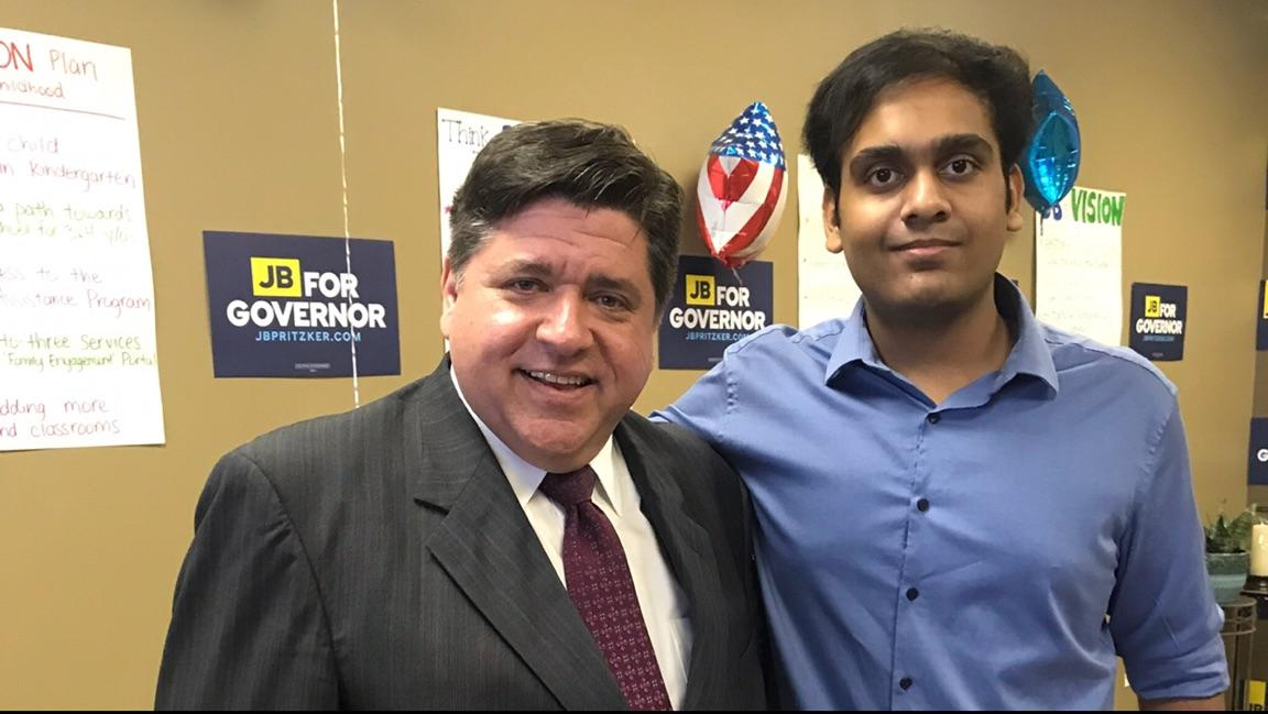 Gubernatorial candidate J.B Pritzker with junior Umar Ahmed, who volunteers on his campaign.