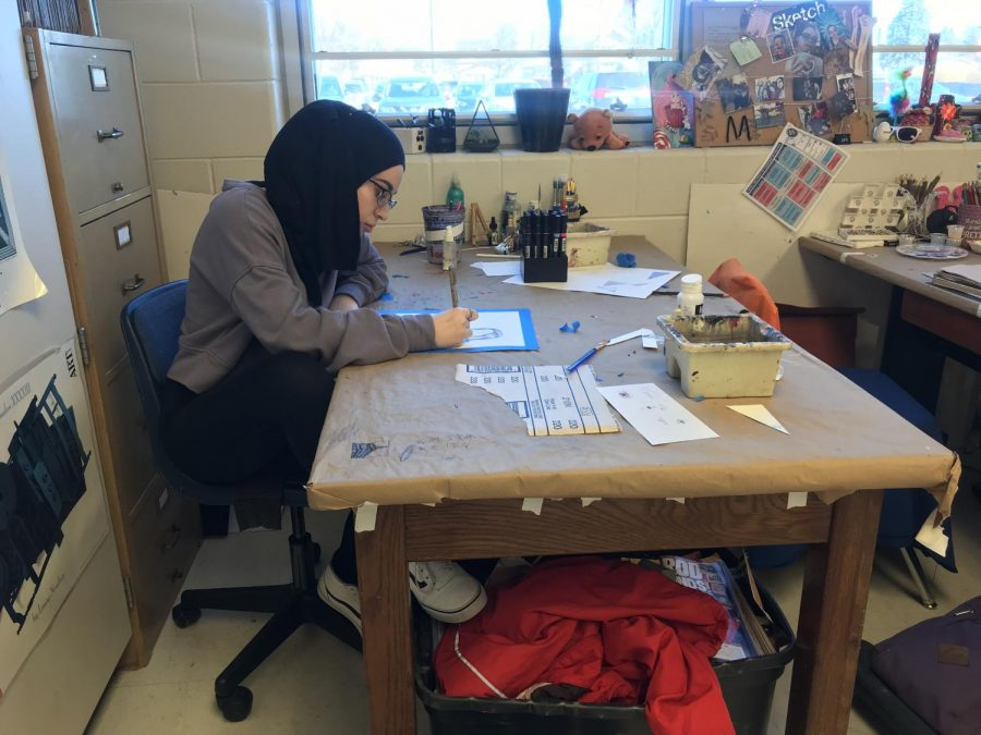 Junior Safiyah Rizvi is in her element when she works on her artwork during her second period AP Studio Art class.