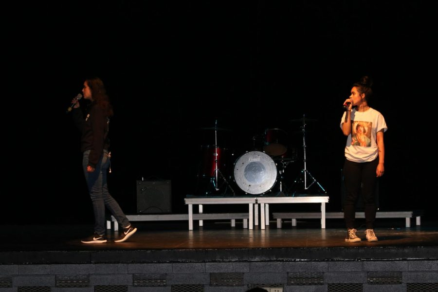 Penelope Alegria (left) and Sarah Montes (right) practicing their spoken word