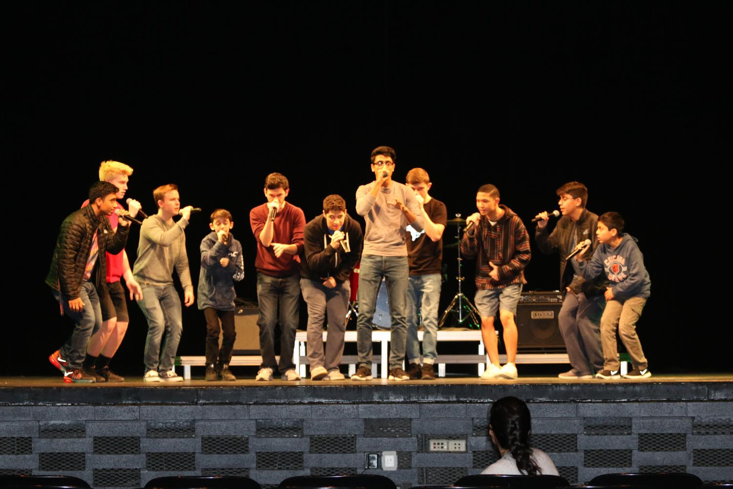 All male acapella group Echo Effect practicing their song