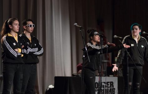 Members of Niles West's poetry team, A Tribe Called West, perform onstage.