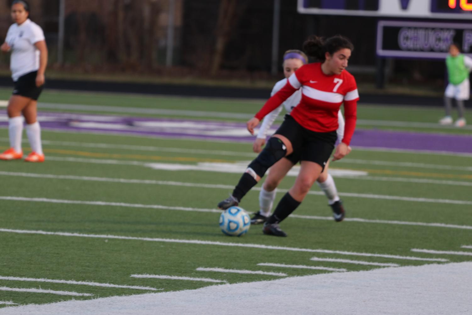 Senior forward Nikoleta Baxevanakis looking to make a pass to start the offensive attack